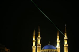 A laser beam points in the direction of the Mecca from a minaret of Mohammed al-Amin mosque  in Beirut
