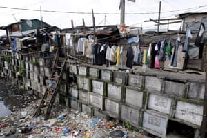 cemetery used as housing in manila