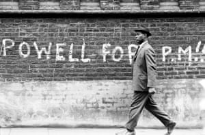 man walking past graffiti 1968