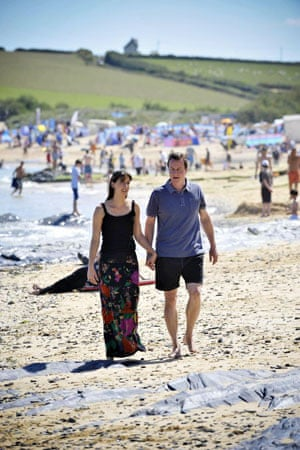 2008, Harlyn Bay, UK:  David Cameron and his wife Samantha relax on the first day of their summer holiday