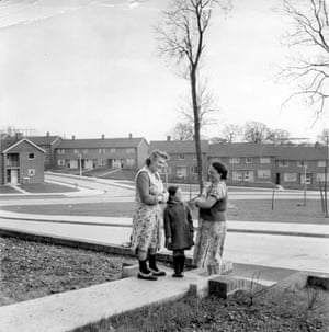 Two women and a child chat in the garden of a Council house 1954