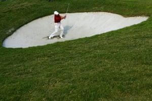 Paul Casey plays a bunker shot