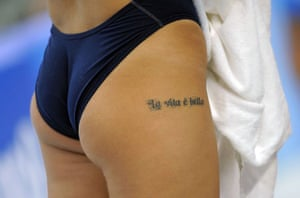 A tattoo on a swimmer's thigh during a training session