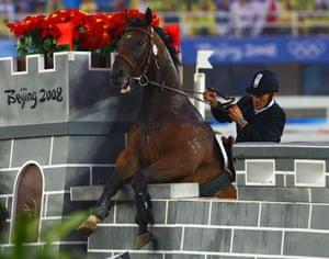 Terrible horse jumping