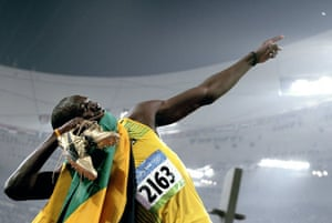 amaica's Usain Bolt celebrates winning the men's 200m final