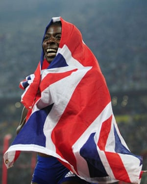Christine Ohuruogu of Britain celebrates winning the women's 400m final