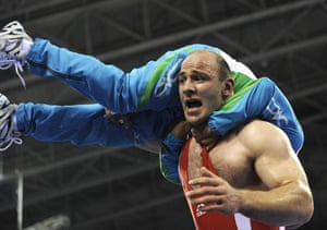 Artur Taymazov celebrates the gold medal with his coach