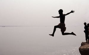 A boy jumps into the Ganges in Bangladesh