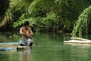 Man on a raft, Bohol, Philippines