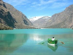 Man rowing boat in Huaraz, Peru