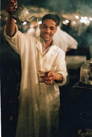 Boy pouring whiskey, Djeem al Fnaar, Morocco