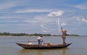 Family fishing, Hoi An, Vietnam