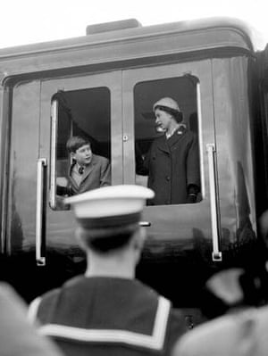 Queen Elizabeth and Prince Charles on a train