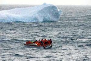 Passengers pass an iceberg
