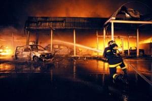 A fireman puts out a fire