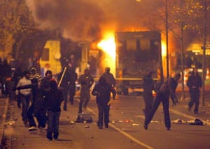 Police and rioters face each other