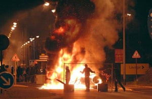 Youths burn garbage
