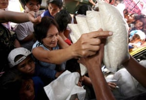 Filipinos buy government-controlled rice sold from a roving truck
