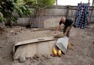 Tskhinvali resident tends to the grave