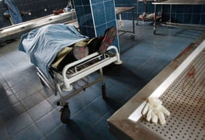 Gori, Georgia: The covered body of a Georgian man  lies in a local hospital after being killed during fighting