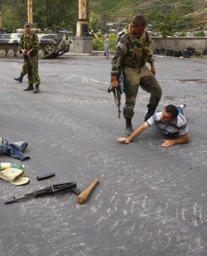 Gori, Georgia: Russian soldiers detain a man who carrying  weapons in his car at a checkpoint