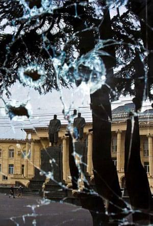 Gori, Georgia: The reflection in a broken window of a statue of former Soviet dictator Josef Stalin