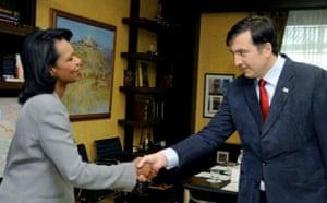Condoleezza Rice shakes hands with Georgia's President Mikheil Saakashvili