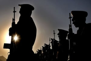 Kabul, Afghanistan: A guard of honor stand in a attention during a ceremony marking the anniversary of Afghanistan's Independence Day