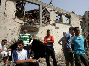 Boumerdes, Algeria: Young men stand in front of a house destroyed in a car bomb attack at the National Gendarmerie school
