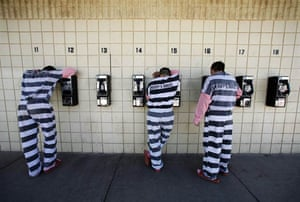 Inmates talk on pay phones Tent City jail