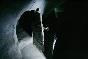 Shiite cleric Sheikh Ahmed Kashef al-Ghataa shows an ancient underground tunnel under his house
