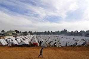 A man walks through a camp in Eldoret
