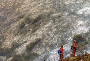 California, US: Firefighters keep a look out along  West Camino Cielo; homes in southern Santa Barbara county are still threatened by a fire in the Los Padres National Forest. Photograph: Mike Eliason/Santa Barbara News-Press/AP