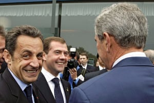 Hokkaido, Japan: The French and Russian presidents Nicolas Sarkozy (l) and  Dmitry Medvedev smile as they meet George W Bush before the G8 summit. Photograph: Dmitry Astakhov/EPA/Pool