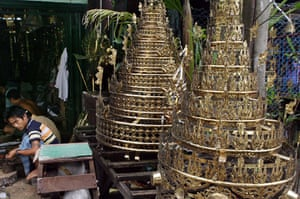 Rangoon, Burma: Two newly made stupas, brass structures placed on the top of pagodas, on display in a workshop. Photograph: AP