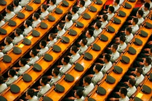 Beijing, China: People's Liberation Army soldiers listen to a speech during a rally at the Great Hall of the People. Photograph: Claro Cortes IV/Reuters