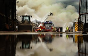 Glasgow, UK: The scene of a fire at Christie and Son scrapyard near Glasgow, which the fire service said could burn for another day or more. Photograph: Danny Lawson/PA Wire