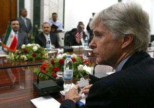 May 28 2007, Baghdad, Iraq: US ambassador to Iraq Ryan Crocker and his Iranian counterpart Hassan Kazemi Qomi, left, attend a meeting on security in Iraq