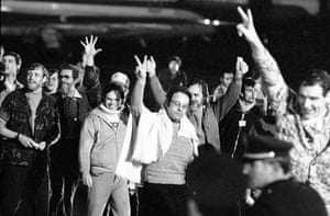 January 21 1981, Algiers: A group of hostages give the victory sign as they emerge from an Algerian aircraft after their flight from Tehran