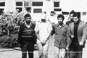 1979, Tehran, Iran: An American hostage is shown before the media by his Iranian captors
