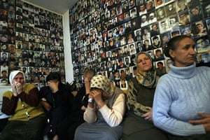 February 2007, Tuzla, Bosnia: Women from Srebrenica react to television coverage from The International Court of Justice in front of a wall covered with pictures of their missing loved ones
