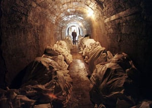 1997, Tuzla: Stacks of unidentified corpses line the walls of an underground shelter at a morgue
