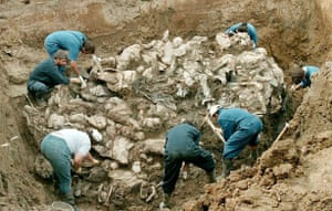 July 1996, Pilica, Bosnia: Forensic experts from the International war crimes tribunal in the Hague work on a pile of partly decomposed bodies found in a mass grave