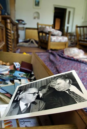 July 2002, Pale, Bosnia: A photo of Radovan Karadzic and Nikola Koljevic lies in his house