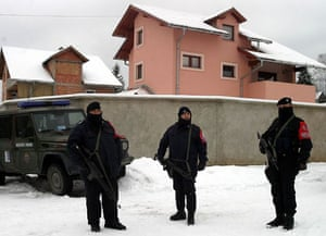 January 2004, Pale, Bosnia: Peacekeepers stand in front of the house of Radovan Karadzic during a search