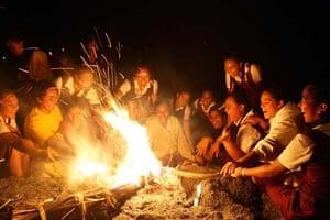 Tongan school children burn torches during the ancient Tupakapakanava ceremony