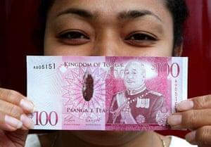 Tongan money featuring the new Monarch
