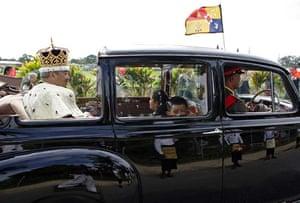 King George Tupou V drives away