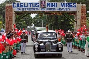 Tongan school children wave flags