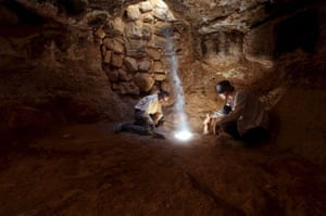 two archeologists work inside ethe cave under the church in the town of Rehab